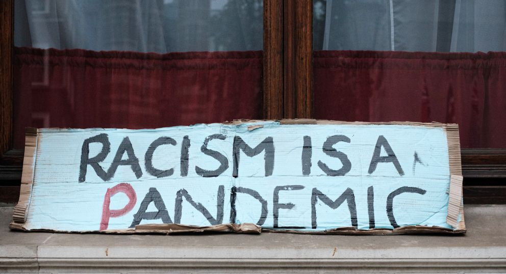 Demo-Plakat: Racism is a pandemic