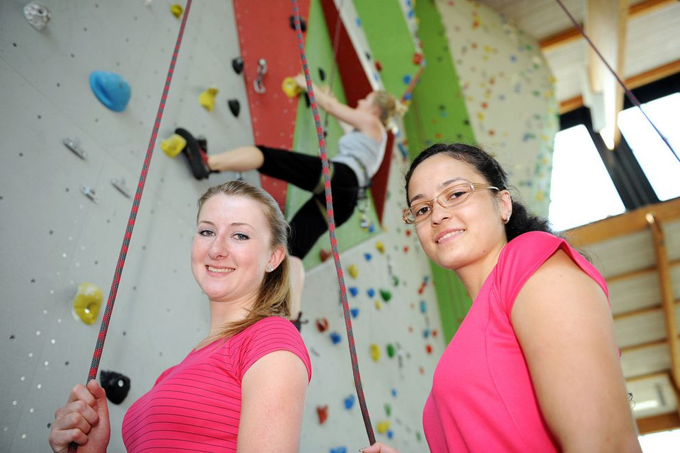 Young women at a climbing wall