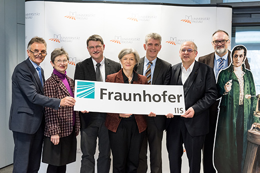 From left to right: Walter Taubeneder (Member of the Bavarian Parliament), Gerlinde Kaupa (Deputy District Administrator), Professor Tomas Sauer, Professor Carola Jungwirth (President of the University), Professor Gerhard Waschler (Member of the Bavarian Parliament), Professor Randolf Hanke, (Head of Fraunhofer Development Center X-Ray Technology) and Jürgen Dupper (Head Mayor of the City of Passau), with a cardboard cutout of Joseph von Fraunhofer, after whom the Fraunhofer Society is named. Photo: University of Passau